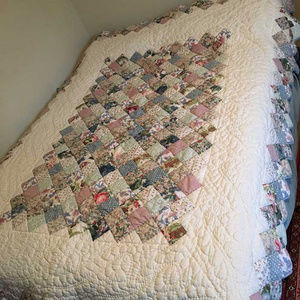 Patchwork hand  quilted 64 by 83 by Impressions